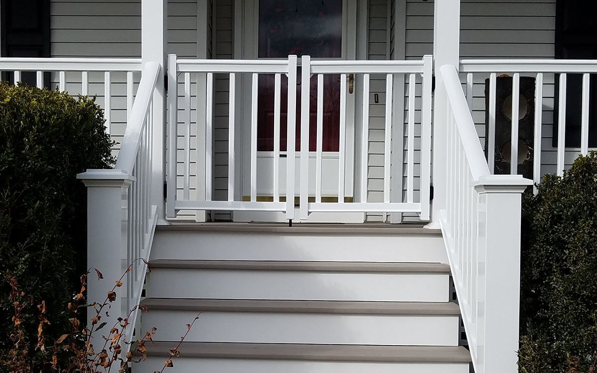 Exterior front porch renovations. Added Azek decking and railings. Added post sleeves. Medway, MA 02053.